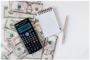 What to do with my stimulus check?- Calculator and cash