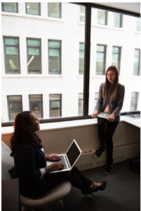 How to deal with negative coworkers- Two women talking